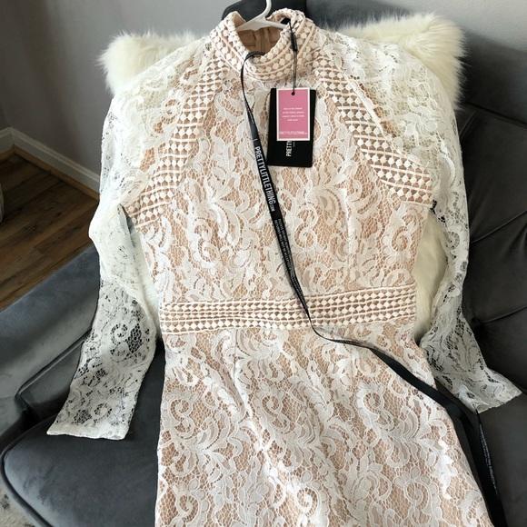 09cd556d09 Isobel White Lace High Neck Bodycon Dress. NWT. PrettyLittleThing.  M 5c4f38949539f7ffc0c34a9a. M 5c4f3896d6dc52473371db1f.  M 5c4f389804e33dcb5dcb7fe2